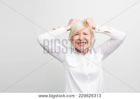 Stressful And Old Woman Is Keeping Her Hands On Her Hand And Showing Some Depression Emotions. She I