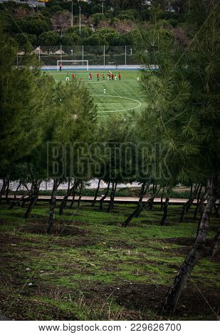 Football Players In Practise Around Scenery Of Madrid