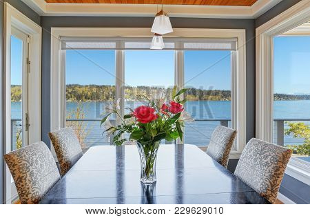 Light Dining Room With Beautiful View Of Lake Washington