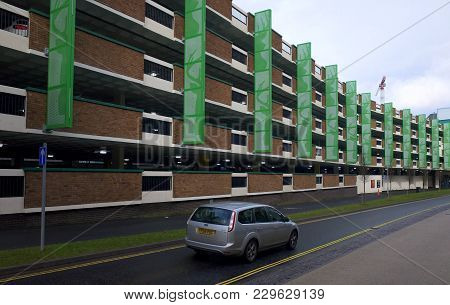 Bracknell, England - March 04, 2018: A Car Passes By One Of The Multistory Car Parks In Bracknell, E