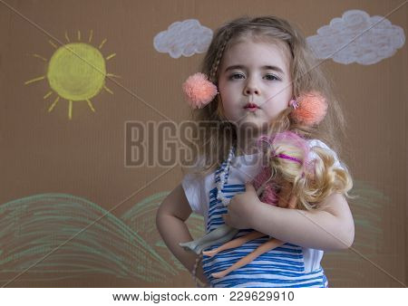 Little Girl Playing With Her Baby Doll And Pretending Mom. Little Girl And Doll