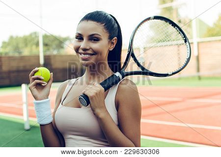 Tennis Professional Beauty. Beautiful Young Woman Holding Tennis Racket And Looking At Camera With S