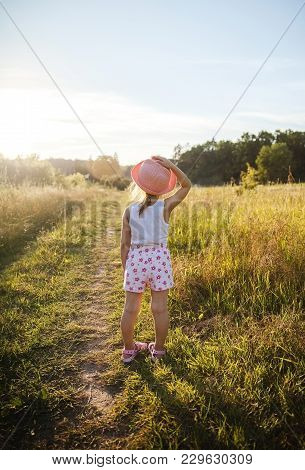 Beautiful Little Girl In The Field At Sunset. Nature, People
