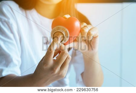 Hands Holding Stethoscope To Checking Red Heart From Patient,health Care Checking Concept,selective