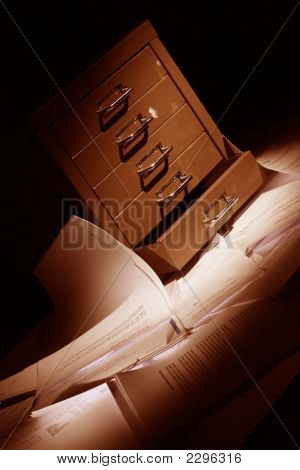 Filling Cabinet With Documents All Over The Floor