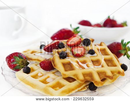 Viennese Waffles With Berries. Wafers With Strawberries And Currants. Fresh Baked Waffles On A White