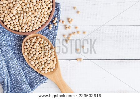 White Wood Floor With Wooden Cup With Soybean Top View And Copy Space Soybeans In Wooden Bowl With W
