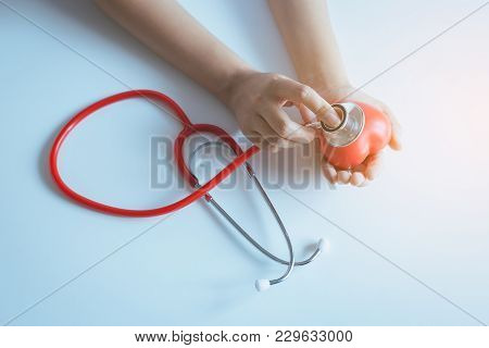 Woman Doctor Hands Holding Stethoscope To Checking Red Heart From Patient,health Care Checking Conce