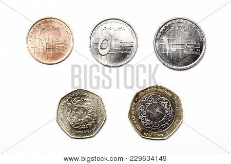 Jordanian Coins On A White Background - Dinar
