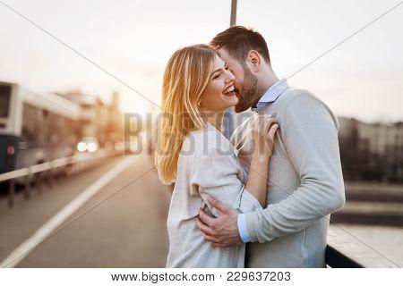 Couple Kissing Dating On Bridge During Sunset