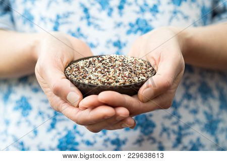 Close Up Of Woman Holding Bowl Of Quinoa