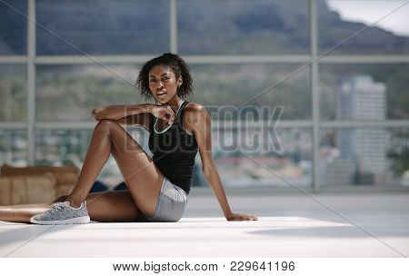 African Woman Relaxing After Workout.