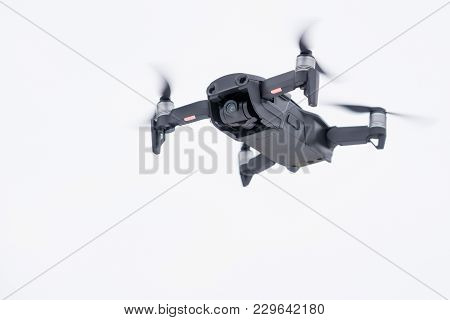 Pancevo - Serbia 03.01.2018. Dji Mavic Air Drone Flying Mid Air Isolated On White Bacground. Smalles