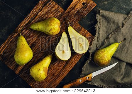 Green Pears On A Cutting Board. Half Of A Pear. Country Style