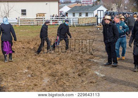 Amish Going Through Mud