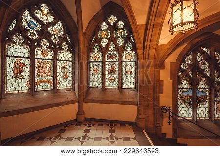 Munich, Germany - November 17, 2018: Windows With Stained Glass Of Gothic Style New Town Hall, Neues