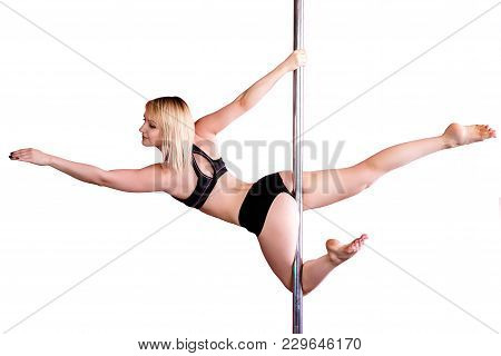 Young Athletic Blond Girl  Doing Strength Exercises On A Pylon. Isolated On White Background. Pole D