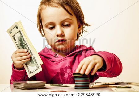 The Concept Of Card Games. The Little Child Girl Gambler Bets On Poker Games.