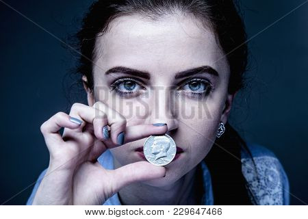 Business Woman Covering Her Mouth With A Coins As Symbol Of Bribery, Cheating, Financia And L  Polit