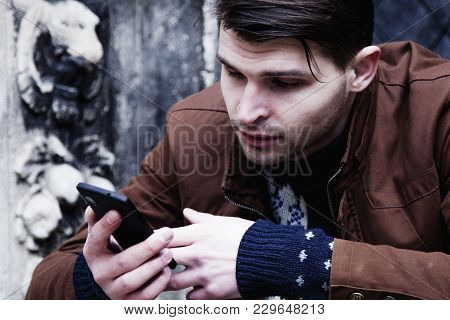 Social Media Addiction. Young Man Holding A Smartphone(psychological Problems, Media Mania)