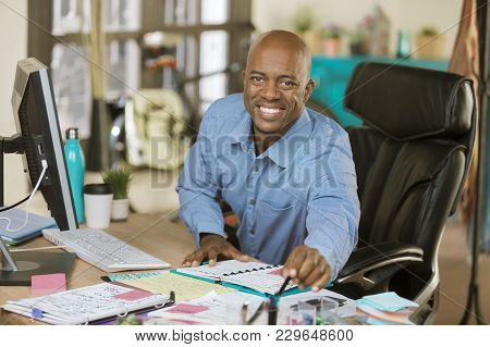 Busy Professional Man Working In A Creative Office