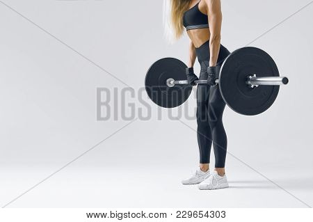 Close-up Conceptual Photo Of Attractive Fitness Model Is Showing Exercises With Barbell Sporty Woman