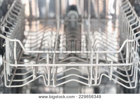 Empty Basket In A Dishwasher From The Front, Copy Space In The Blurry Background, Slected Focus, Ver