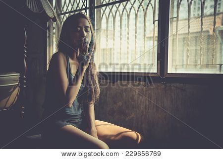 Young Woman Vaping, Blowing Cloud Of Smoke. Nicotine Addiction Toxic Dangerous For Healthy. Girl Smo
