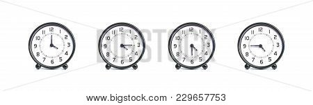 Closeup Group Of Alarm Clock For Decoration Show The Time In 4 , 4:15 , 4:30 , 4:45 P.m. Isolated On