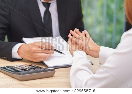 Customer Or Woman Says No Or Hold On When Businessman Giving Pen For Signing A Contract.