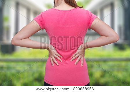 Female Athlete Lower Back Painful Injury. Sporty Woman Backache And Injury