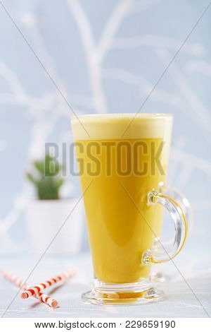 Turmeric latte a golden twist to coffee, The drink is made by steaming milk with aromatic turmeric powder and spices