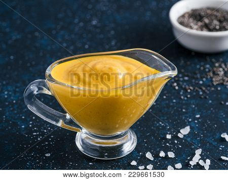 Creamy Cheddar Sauce With Chia Seeds On Dark Background.ideas And Recipe For Healthy Diet Or Vegan F