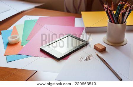 Creative Digital Learning Desktop Table  Concept With Ebook, Pencils, Paperclips, Eraser, Scotch Tap