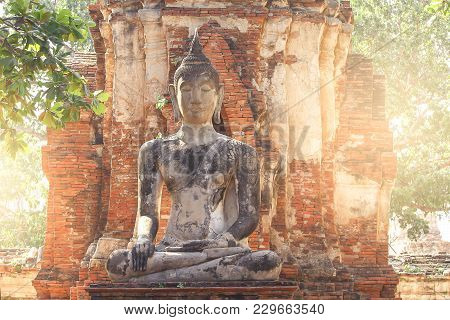 Contra Ligth Sitting Buddha Statue In Wat-mahathat Temple Of Ayutthaya Thailand