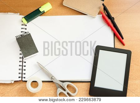 Empty Note Book On A Office Or Student Composition With Scissors, Scotch Tape, Note Blocks, Yellow M