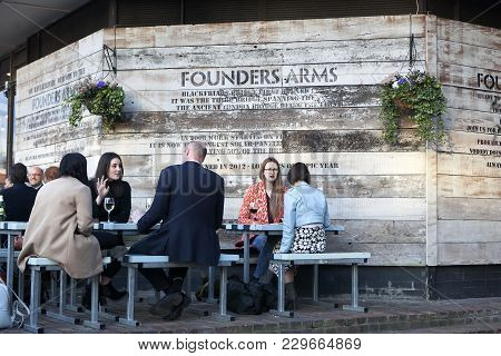 London, Uk - August 27, 2016: People Are Drinking Wine Near The Bar Founders Arms In The Street On T