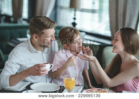 Young family eating in a restaurant