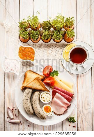 Breakfast with eggs and sausages