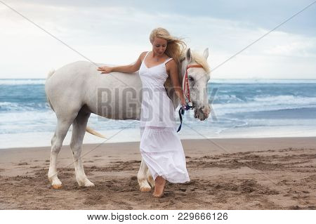 Beautiful Young Woman Walking With Horse At The Beach, Horseback And Equestrian. Lady With Horse Nea