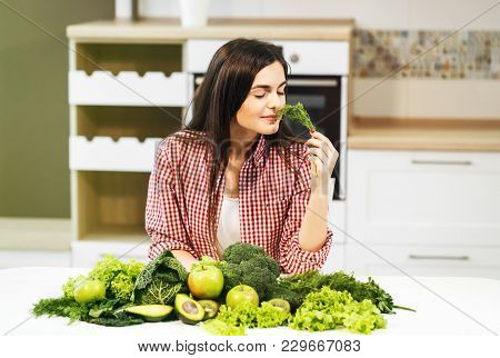 Happy And Beautiful Woman, In Casual Checked Shirt And White T-shirt, Indoor Shot At Kitchen Table,