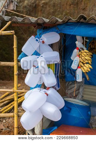 Talakaveri, India - October 31, 2013: Closeup Of Empty White Plastic Water Jugs Hanging At Merchand