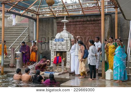 Talakaveri, India - October 31, 2013: People Perform Bathing Ritual In The Spring Of Kaveri River In