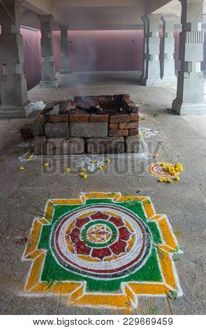Talakaveri, India - October 31, 2013: Square Stone Fire Pit Wherein Offerings Are Burnt And Colorful