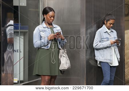 London, Uk - July 17, 2016. People Are Waiting For Friends Near Covent Garden, Buried In Mobile Phon