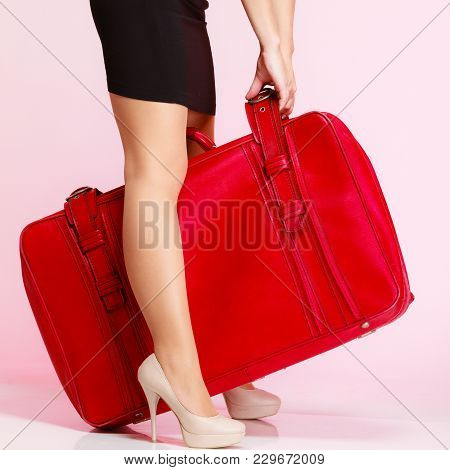 Side View Woman Legs High Heels With Old Red Suitcase On Pink Background. Elegant Lady In Voyage, Tr