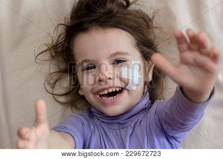 Hands And Face With Adhesive Plaster Of Young Kid Girl