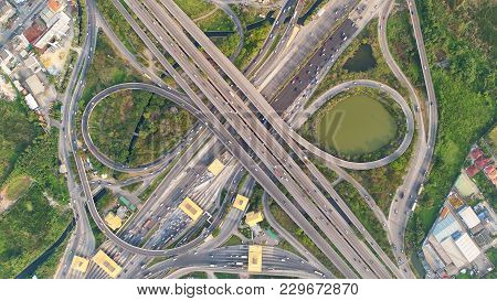Top View City , Aerial View Road , Expressway With Car Lots In The City In Thailand. Beautiful Stree