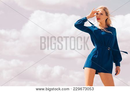 Fashionable Woman Wearing Blue Jumpsuit Shorts Perfect For Summer. Fashion Model Outdoor Photo Shoot