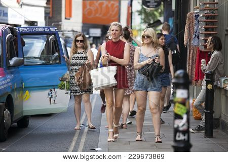 London, Uk - August 27, 2016: Hipster Gilrs Dressed In Cool Londoner Style Walking In Brick Lane, A